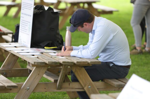 Defra Future Farming - man writing at table